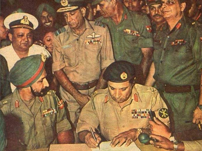 Pakistani General Niazi signing the instrument of surrender at Dhaka Race Course