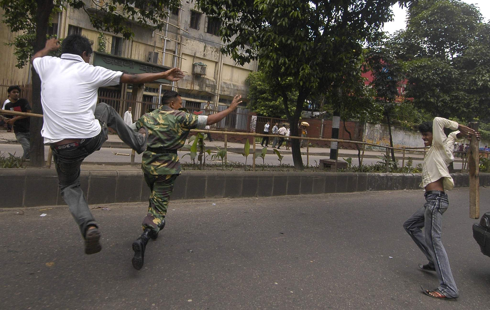 Dhaka University student kicking an army man